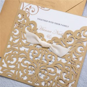 gold envelope pocket invitation suite with ivory knot bow