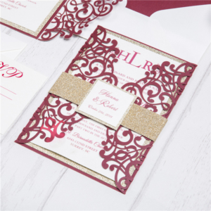 red invitation with gold belly band