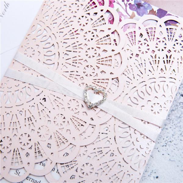 pink invitation with rhinestone